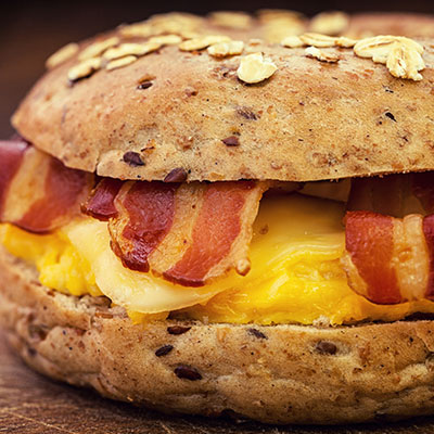Tasty breakfast sandwich with egg and bacon