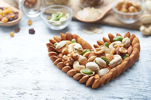 Delicious snack of almonds and pistachios